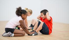 Kids doing sit ups