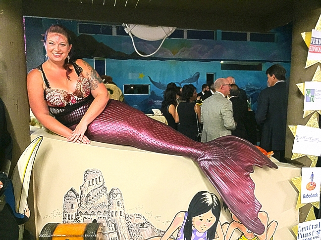 Mermaid Janelle Raymond is part of the fun scenery at Discovery Museum's annual fundraiser. Photo by Heather Hamer