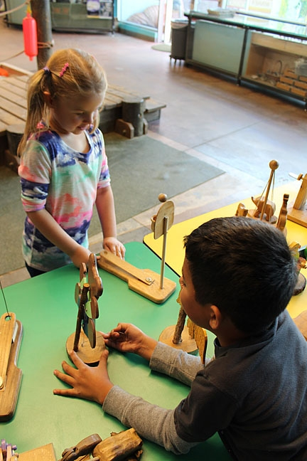SIMPLE TOYS, SIMPLE FUN: The Santa Maria Valley Discovery Museum's new wooden toy collection is fun for various ages and interests, fostering interaction and good old-fashioned fun.