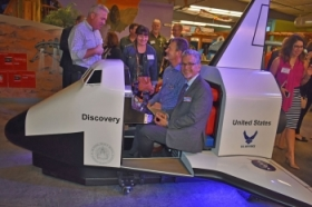 Roy Reed takes the new Discovery space shuttle exhibit at the Santa Maria Discovery Museum for a test ride on Wednesday night. The exhibit was unveiled at a special reception where officials also announced a new educational partnership with Vandenberg Air Force Base. (Janene Scully / Noozhawk photo)